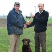 Edward Luisetti presents the Luisetti Seeds Paddock of the Year cup and prize to Guy Slater (and dog Moby).