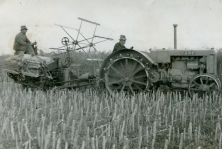 Black and whie photograph of Dick Morrish in 1933 using farm machinery