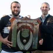 Jono Young of Luisetti Seeds presents the Luisetti Seeds Coleman Shield to victorious Waihora captain, Ryan Koning