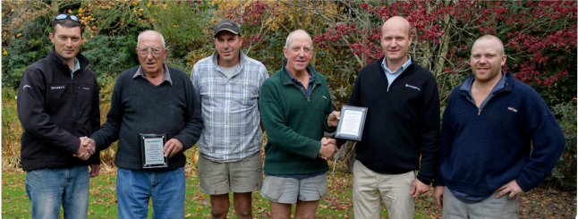 Luisetti Seeds staff present members of the Morrish family with commemorative plaques