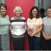 Image of Margaret Luisetti, Robin Hassall, Nikki Luisetti, Gaynor Hurford holding a silver plate
