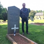 Vincent Luisetti places a white cross on the grave of Pietro Luisetti, one of few New Zealand soldiers buried on British Soil. The cross was gifted by Rangiora Museum.