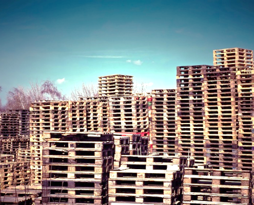 Pallets stacked at a landfill site