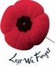 Armistice red poppy, with the words Lest We Forget