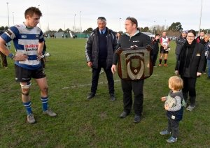 Simon Fleetwood from Luisetti Seeds presents the Coleman Shield to captain of the Southbridge team Luke Palmer.