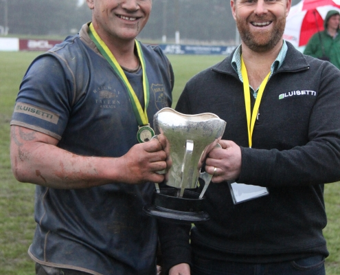 Peter Ayers presents the Luisetti Seeds Watters Cup to captain of the Rakaia team, Jackson Dolan