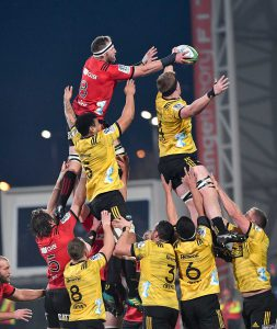 Crusader player is lifted high in the air by his teammates.