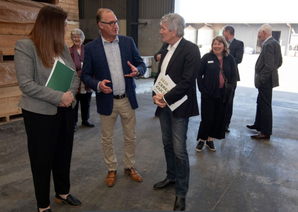 Vincent Luisetti (centre) describes the process of cleaning seed for export markets to Jo Luxton MP and the Minister of Agriculture Hon Damien O'Connor